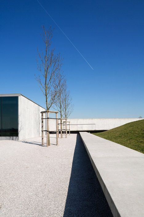 This minimal concrete and glass pavilion in Belgium marks the entrance to a First World War cemetery