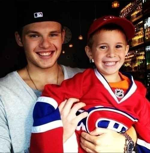 Montreal's Alex Galchenyuk and this delighted little fan in his way-too-big jersey. | 50 Adorable Pictures Of NHL Players With Kids That Are Going To Melt Your Ovaries