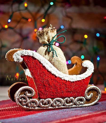 Beautiful Gingerbread Sleigh - decorated with red sugar and refined sugar. Skids are decorated with silver, candy balls.