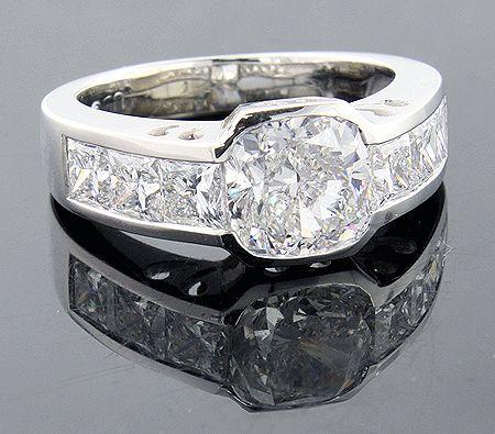 custom-made 3-carat cushion cut diamond engagement ring with princess cut sides by itshot.com