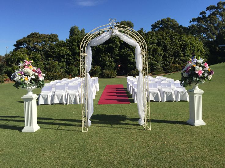 Outdoor ceremony set up at Wantima Country Club by One Stop Wedding Shop
