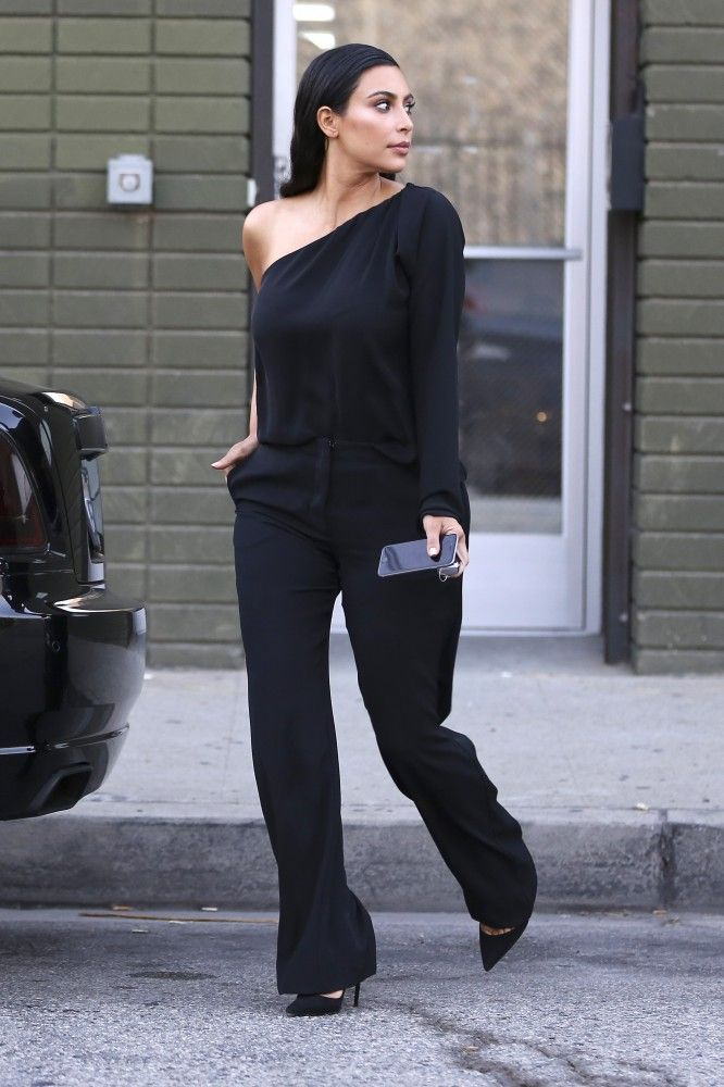 Kim Kardashian looks chic in an off-the-shoulder blouse