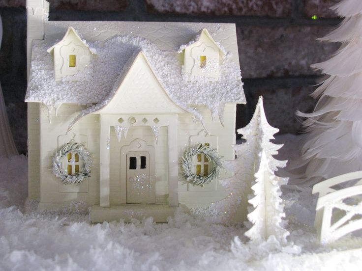 a Christmas cottage by the sea.   Martha Stewart has a wonderful pattern that would work really well for a recreation of this wee house.