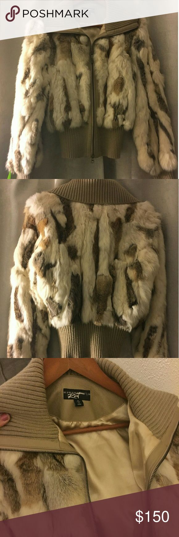 Beautiful Black Rivet Fur Coat White and Brown Fur Coat with tan colored leather trim. Medium size..Price is negotiable.. Black Rivet Jackets & Coats Capes