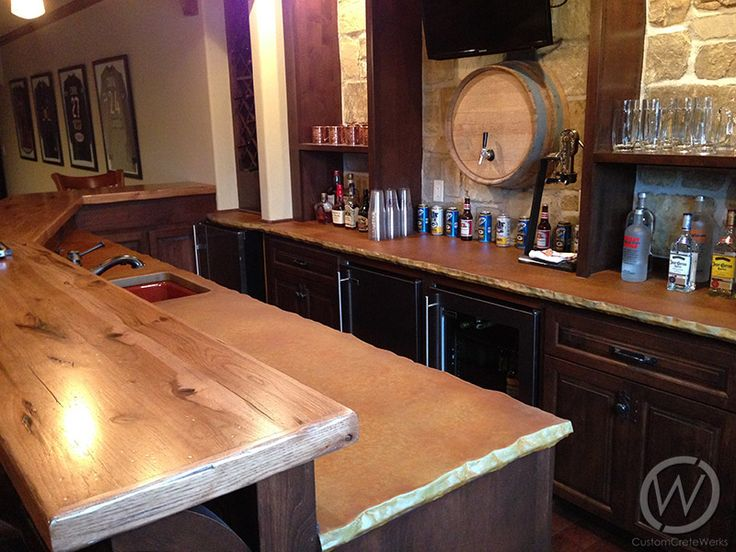 Concrete bar countertop with chiseled edge and wood bar top. Concrete made by CustomCreteWerks.