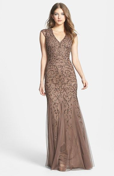 Free shipping and returns on Aidan Mattox Beaded Cap Sleeve Gown at Nordstrom.com. A beautiful silhouette is the hallmark of a flattering gown. This one, in lightweight mesh overlaying a fitted sheath, is shaped with cap sleeves and an alluring V-neckline. Dense beading on the bodice gives way to a delicate tracery from the waist down, emphasizing the flared mermaid silhouette.