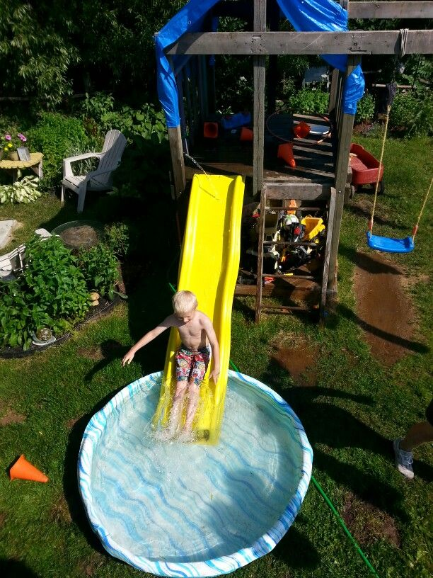Fort waterslide Wedged hoze in fort spraying onto slide with kiddie pool at the bottom