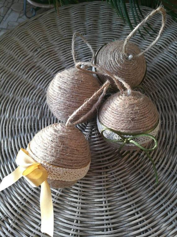 A beautiful handmade Christmas ornament for your tree in recycled jute rope. This ornament was crafted using off natural colour jute rope on a styrofoam ball for a rustic look. These balls can be crafted either plain looking or with ribbon and lace. You could also chose to have