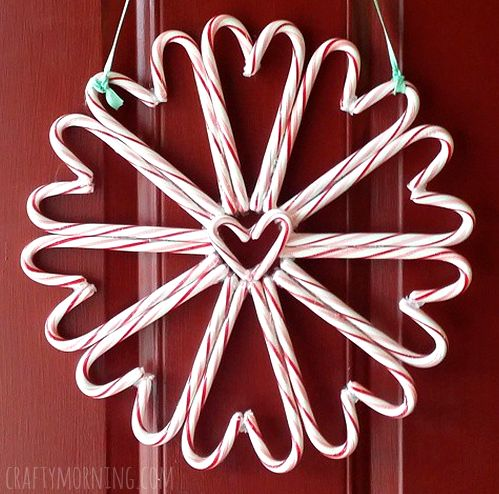 Candy cane wreath for a christmas decoration on your door! All you need is a hot glue gun, candy canes, and string.