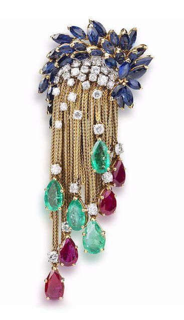 A diamond, emerald, ruby and sapphire brooch, by Marchak, circa 1965. Via Bonhams.