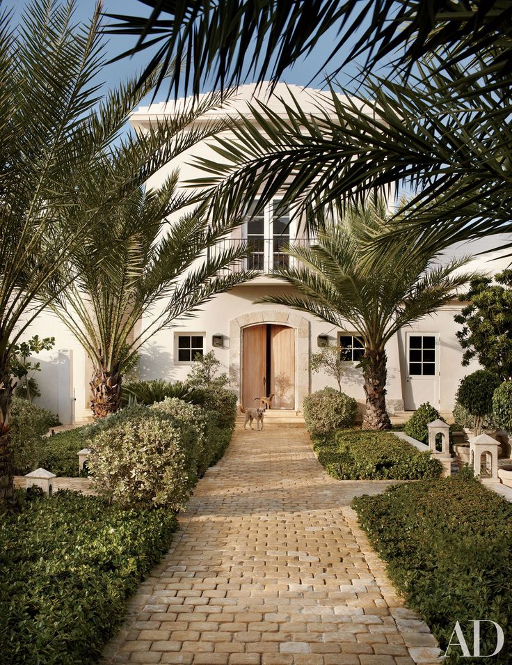 Classicism meets tropical comfort at an oceanfront estate in the Dominican Republic designed by Genevieve Faure.