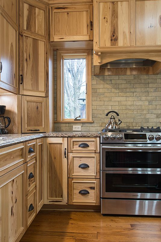 Earthy tones of the rustic hickory cabinets, brown brick ... on Farmhouse:-Xjylc6A2Ec= Rustic Kitchen  id=64368
