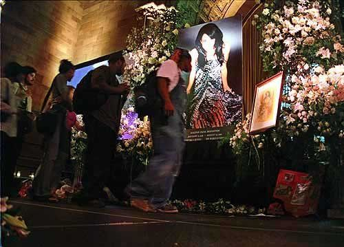 Aaliyah's funeral.It was so crowded. They had white doves released.