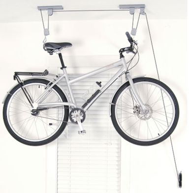 Ceiling Bike Hoist: Ceiling Bike Hoist  Raise and store your bike, kayak, or extension ladder using the same principles you would to raise and lower a mini blind. The smooth pulley system has an automatic mechanism to prevent accidental release. Available from OrganizeIt.com, $34.99