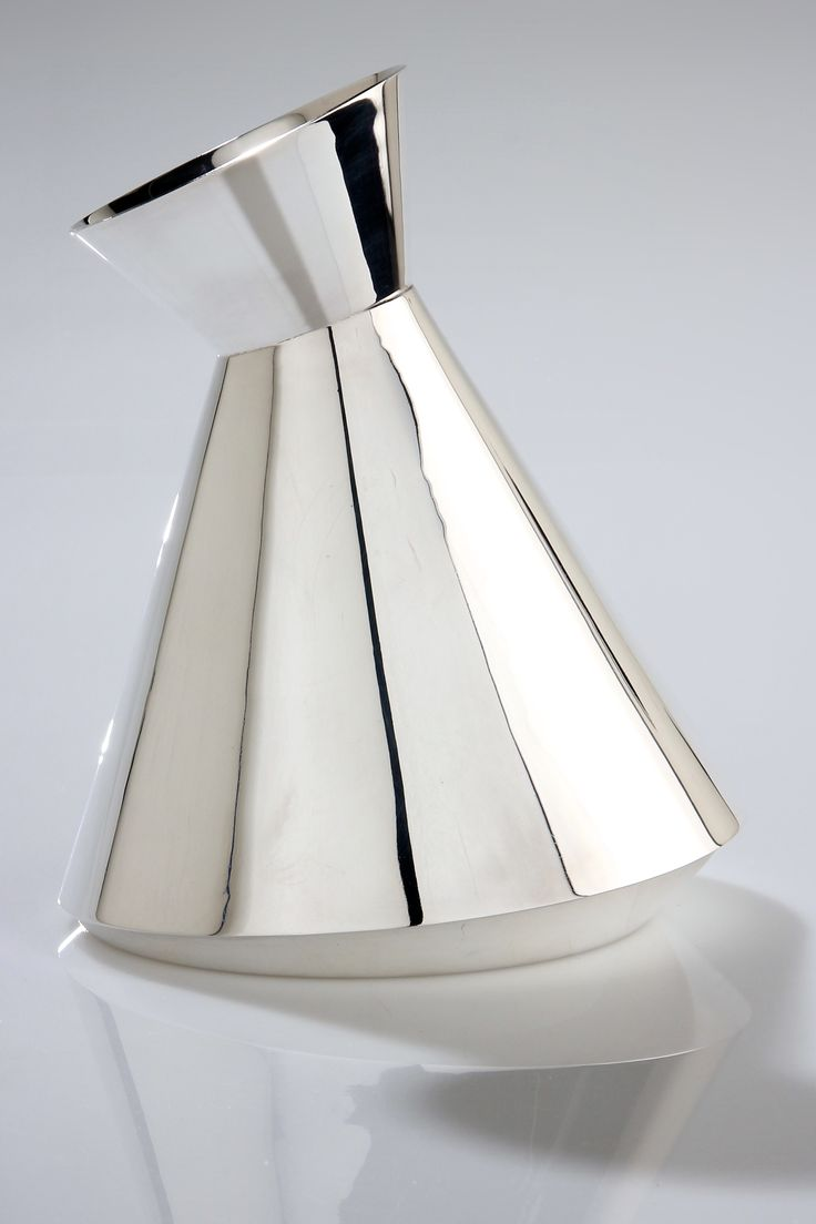 Loucinda Nims ...Inspired by the form of water droplets and stone settings, the 'Bezel' Carafe is based on a traditional carafe but presented in a contemporary way. Each piece is cut at an angle which causes the carafe to appear tilted. The spout is finished in a way which replicates a bezel stone setting.
