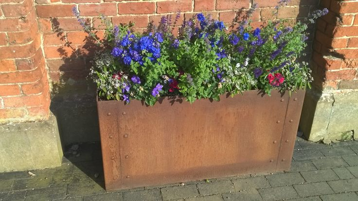 The Cor-Ten steel used for this patio planter really works well in creating a rustic appearance. Despite appearances, The Cor-Ten steel is very durable and protects from corrosion.