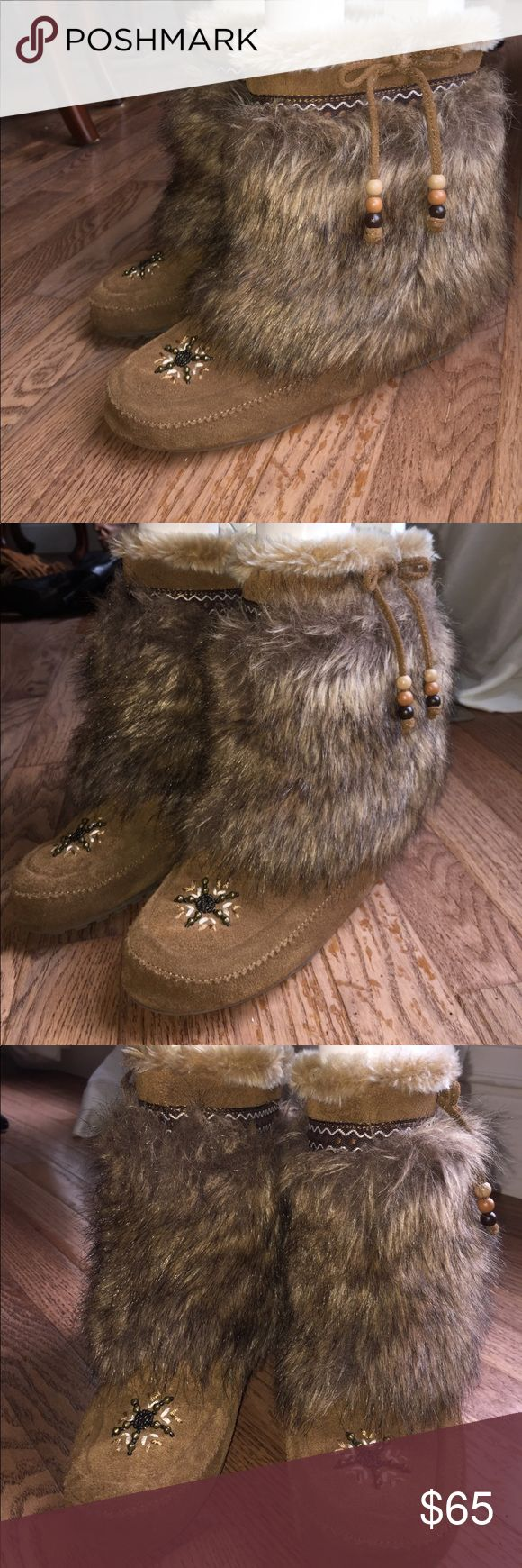 Minnetonka fur moccasin ankle booties Gently used, these boots are in almost perfect condition. They feature real leather upper and faux fur. There is a cute little design that goes around the top of the booties. True to size! I'm open to all offers!! :) Minnetonka Shoes Ankle Boots & Booties