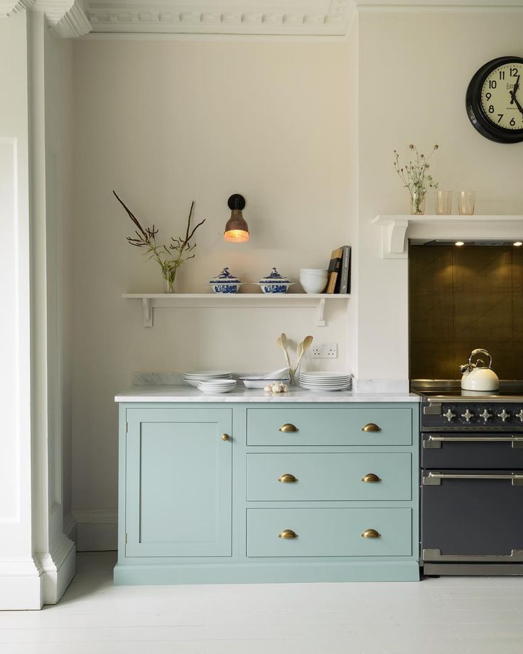 10 Amazing English Country Kitchens by deVOL. deVOL kitchen's South Wing Kitchen. You can't go wrong with Trinity Blue cupboards, especially when they're paired with smooth pale worktops, walls and floors - what a beautifully simple and peaceful combination. Notice these cupboards are fitted away from the walls too, this created the bespoke and freestanding feel to the room that the customers really wanted but it was all done using standard sized cupboards from our Shaker range. #deVOLKitchens