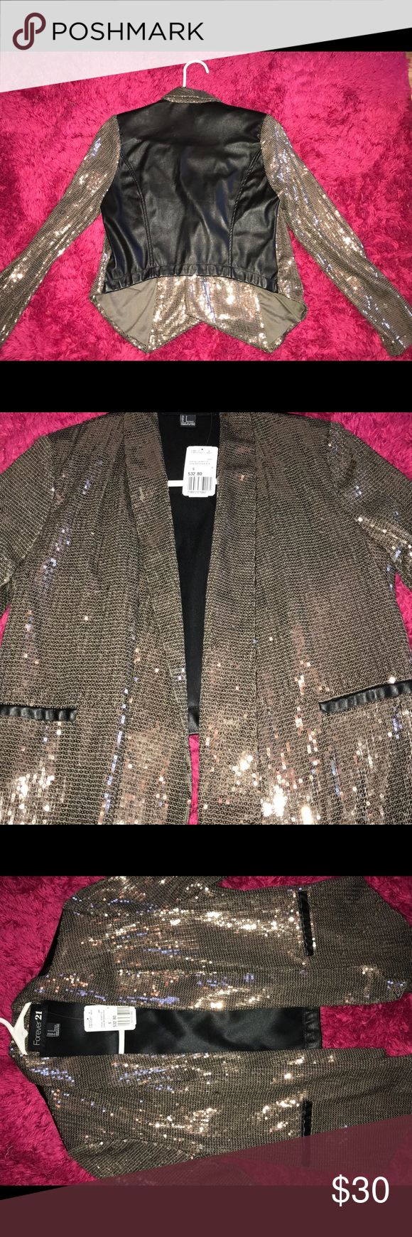 Sparkly Sequence jacket. Perfect for New Years. Thin jacket, will compliment well with a simple dress or a pair of jeans with a solid top. No need to accessorize because this jacket is an eye catcher. Throw on a pair on earrings and your good to go! Forever 21 Jackets & Coats