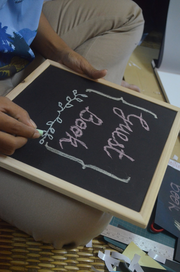Making a guest book signage for a friend's wedding.  This is not a real chalk board, y'know.  :)