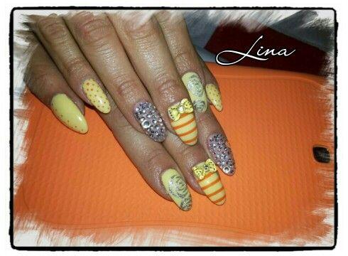 Yellow pastel with swarovski 3dbow and handmade nail art!!