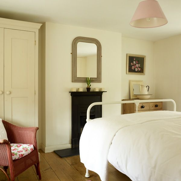 Our main cottage bedroom with original Lloyd Loom chair