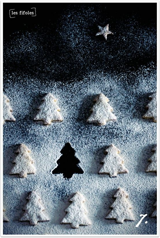 Christmas tree cookies with powdered sugar snow.