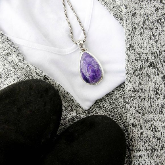 Spice up your fall wardrobe with a pop of colour by incorporating our stunning natural gemstone jewelry into the mix!    Charoite Pendant - Transformation Collection  #jewelry #fall #autumn #ootd #gemstone #gemstones #gems #fashion #accessories #jewelrygram #necklace #chic #healing #reiki #chakras #yoga #silver #nature #style #minimal #purple #weekend #work #nightout #healingstones #crystalhealing #fallfashion #flatlay #gift #sweaterweather