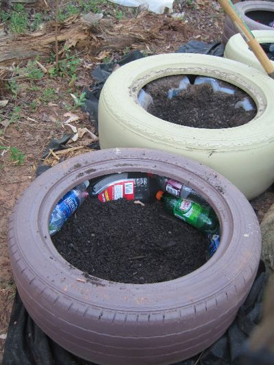 TIRE GARDEN | Used plastic bottles for filler.