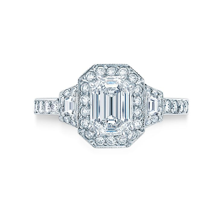 Art Deco #Emerald Cut Ring   modern design influenced by the art deco period of the 1930's this ring features an #emerald cut #diamond with trapezoid and brilliant cut accent diamonds.   #engagement