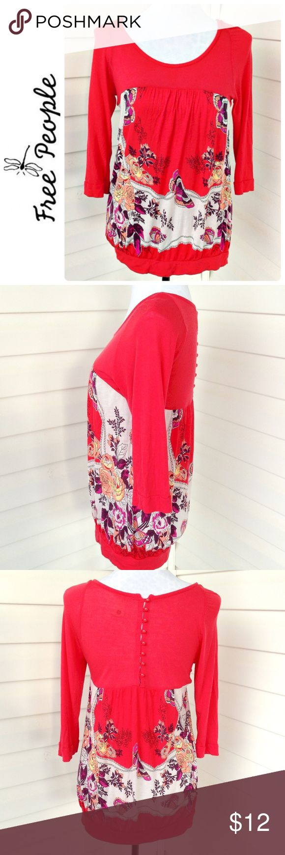 """❣️BOGO Free ❣️ Free People Red Tunic Red stretchy tunic with very pretty butterfly and floral design.   Fits Size S-M Tag says L but definitely runs small.  Length 26""""  Armpit to armpit 16"""" 3/4 sleeves  100% viscose  Good preloved condition with slight pilling under sleeves and bottom band. Shirt is still very wearable and very cute!! Free People Tops"""