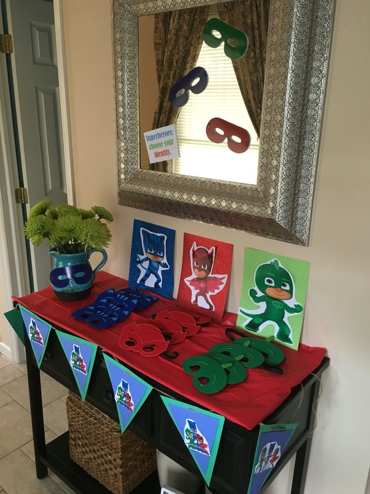 PJ masks birthday party favors. Superheroes choose your identity. I printed each superhero and glued it to sparkly glitter paper from Michael's. I bought the masks on EBay!