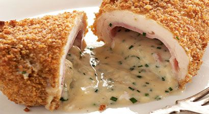 "Rocco DiSpirito's Lightened Chicken Cordon Bleu:  ""DiSpirito's cheese sauce is so creamy, it's hard to believe it's made without butter."""