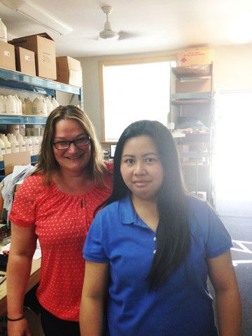 Behind the Scenes at MTSO | Massage Therapy Supply Outlet - vera and gail stop for a quick photo before getting back to filling orders