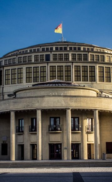 CENTENNIAL HALL, Poland: was constructed according to plans of the architect Max Berg from 1911–1913, when the city was part of the German Empire. It is an early landmark of reinforced concrete architecture. The opening of the hall was part of the celebration commemorating the 100th anniversary of the battle which drove off Napoléon. It was opened, with grounds including a Japanese garden, on 20 May 1913 in the presence of Crown Prince William of Hohenzollern.
