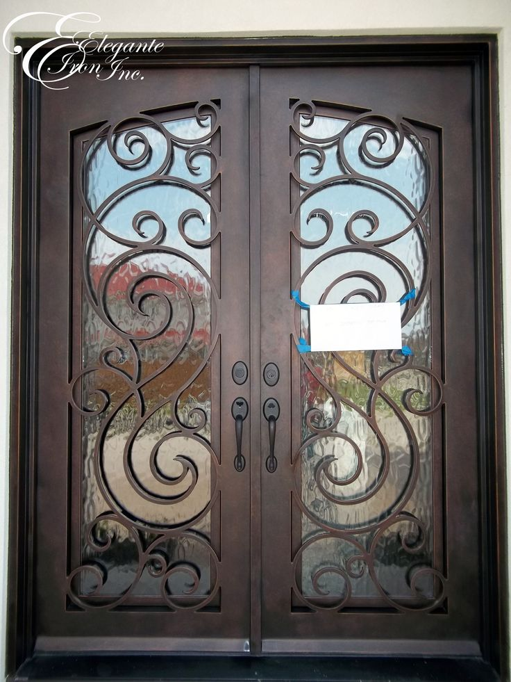 Custom wrought iron front door with eyebrow arch grille for Wrought iron front doors