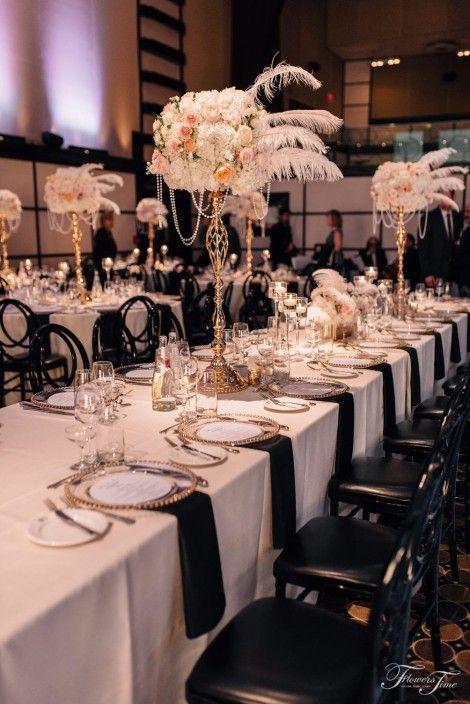 Gatsby style wedding centerpiece feather white flowers