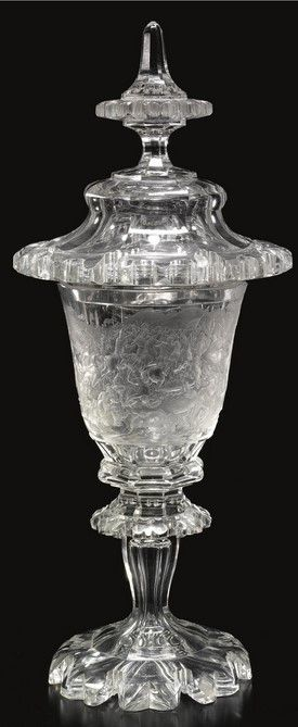 The Granicus Goblet. An important Bohemian glass goblet and cover engraved by August Böhm dated 1845 the thick walled octagonal bowl finely carved with a panel showing a battle scene, after Charles Le Brun, depicting Alexander the Great defeating the Persians on the Bridge over the River Granicus, inscribed below, Gravirt v.A.Böhm aus Meisterdorf i.Böhm im Jahre 1845, the reverse bearing the inscription La Vertu surmonte tous obstacle Alexandre ayant passé le Granique attaque les Perses a…