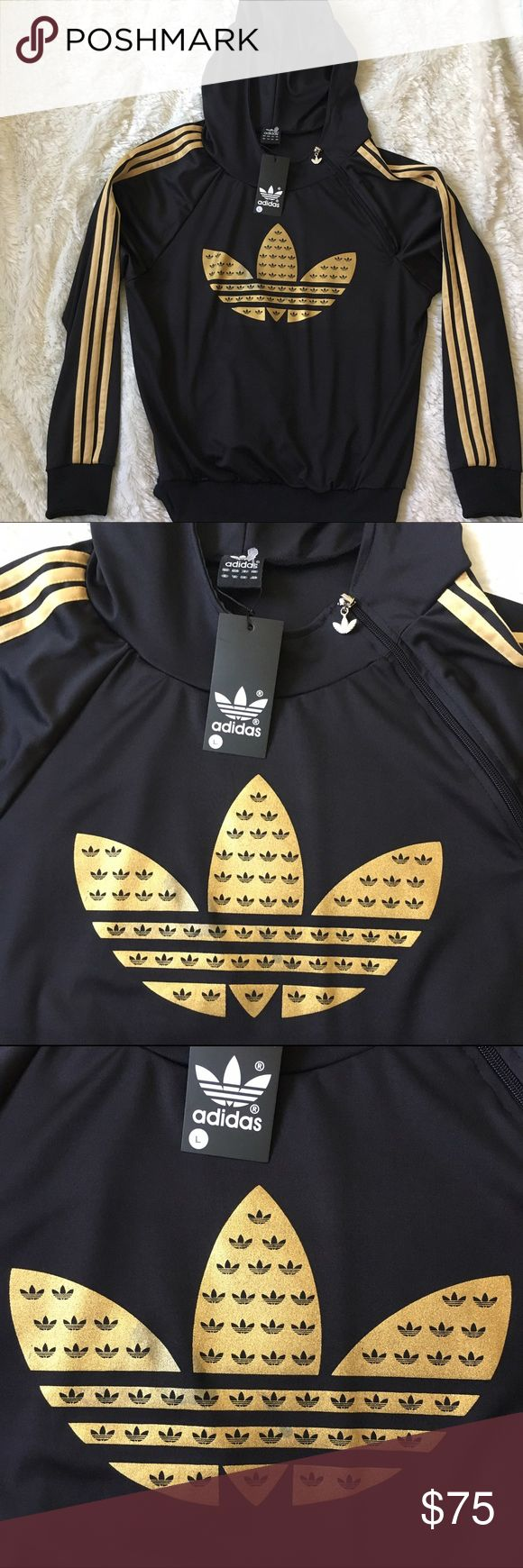 """Adidas Gold & Black Zip Sweater Hoodie Large Adidas Gold & Black Sweater Hoodie has a diagonal collar zip. Classic Adidas gold stripes along sleeves and adidas logo emblem in the middle on the sweater. New w/ tags however please see pics 2 & 3 for slight discoloration of spots on the logo. Very unnoticeable. Zipper has adidas logo attached. Hooded. Size Ladies Large but this runs a little small. Measurements when laid flat: Armpit to armpit is 21"""" & length is 24.5"""". Check out matching sweat…"""