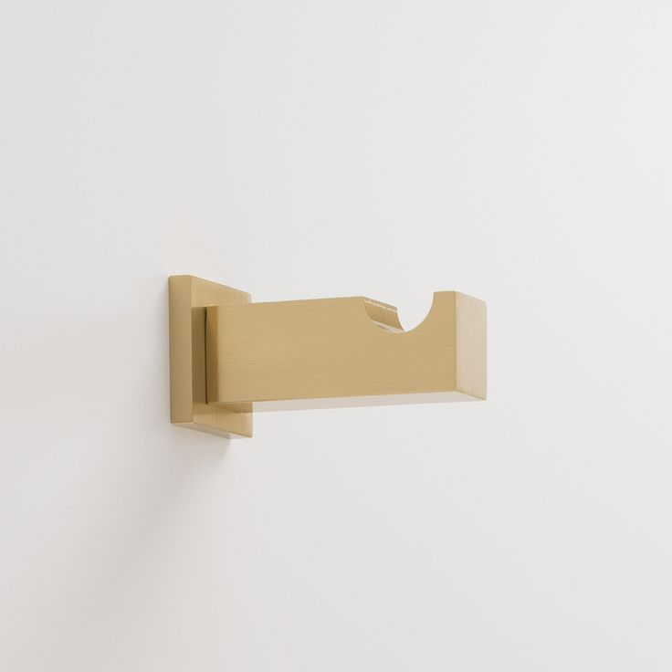 The traditional wall hook is reimagined with geometric shapes and a sturdy silhouette, making it a subtle statement piece for your mudroom, entryway or bath. Handmade from solid brass, it's durable enough to withstand everyday use. Crafted and finished by hand in the US, using 95% recycled brass. Clean with a damp cloth and mild liquid soap. Available in Natural Brass, Matte Bronze or Satin Copper.