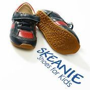 SKEANIE Boys Navy and Red Trainers. Soft leather sneakers. Sizes 4-11  The little man in the house will have the smartest looking feet in town.  And he will not want to take them of they are so comfy.  SKEANIE Navy and Red Trainers are hand made from soft eco-leather. These shoes feature luxurious leather uppers and lining with a flexible rubber sole.