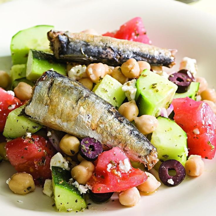 The fresh, tangy elements of a Greek salad--tomato, cucumber, feta, olives and lemony vinaigrette--pair well with rich-tasting sardines. Look for sardines with skin and bones (which are edible) as they have more than four times the amount of calcium as skinless, boneless sardines. If you're lucky enough to have fresh sardines available in your supermarket, try them in place of the canned sardines. Lightly dredge them in salt-and-pepper-seasoned flour and sauté them in a little olive oil. ...