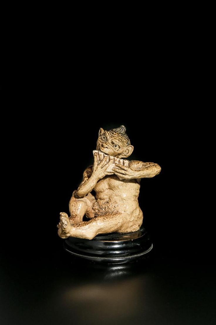 Lot 90 - A rare Martin Brothers stoneware Imp Musician by Robert Wallace Martin, modelled seated playing
