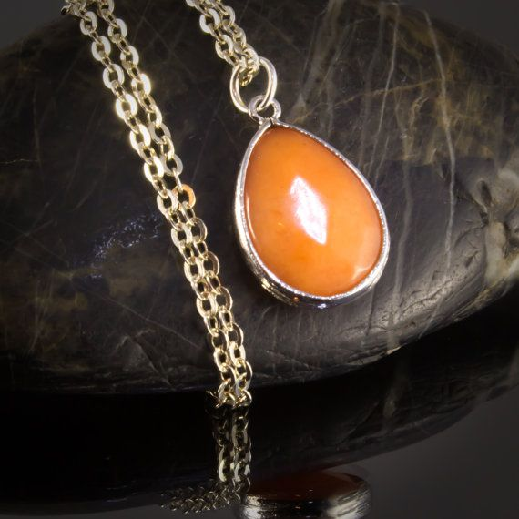 Delightful Halloween pumpkin orange faceted glass pendant on a 20 in silver plated flat cable chain comes with a 2 inch extender to allow for versatility in length. This fall coloured necklace could easily become the centre piece to your layered Halloween arrangement. 614935NSPH