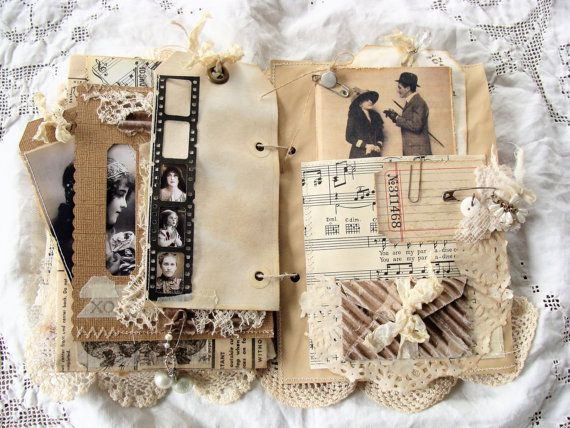Vintage junk journal... Journal covers are constructed from sturdy chipboard. Iv incorporated many vintage and new items, such as vintage sheet music, corrugated card, fabrics, laces, vintage album cover, vintage image, rusty bezel, snippets of lace and ribbon, vintage button, cluster of vintage forget-me-nots, safety pin, rhinestone dangle. Contents include 36 pages, front and back. Pages are a mix of vintage dictionary page - definition of love, vintage sheet music, vintage book pages…