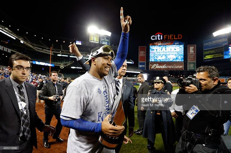 Salvador Perez #13 of the Kansas City Royals celebrates with the World Series Most Valuable Player Award after defeating the New York Mets to win Game Five of the 2015 World Series at Citi Field on November 1, 2015 in the Flushing neighborhood of the Queens borough of New York City. The Kansas City Royals defeated the New York Mets with a score of 7 to 2 to win the World Series.