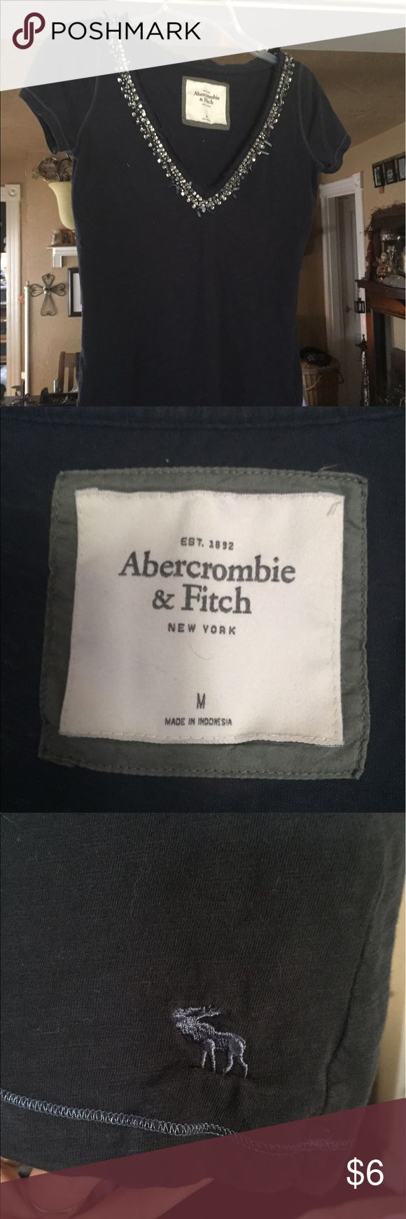 Abercrombie and fitch Tshirt Ladies Abercrombie and fitch Tshirt with embellishment along the vneck collar Abercrombie & Fitch Tops Tees - Short Sleeve
