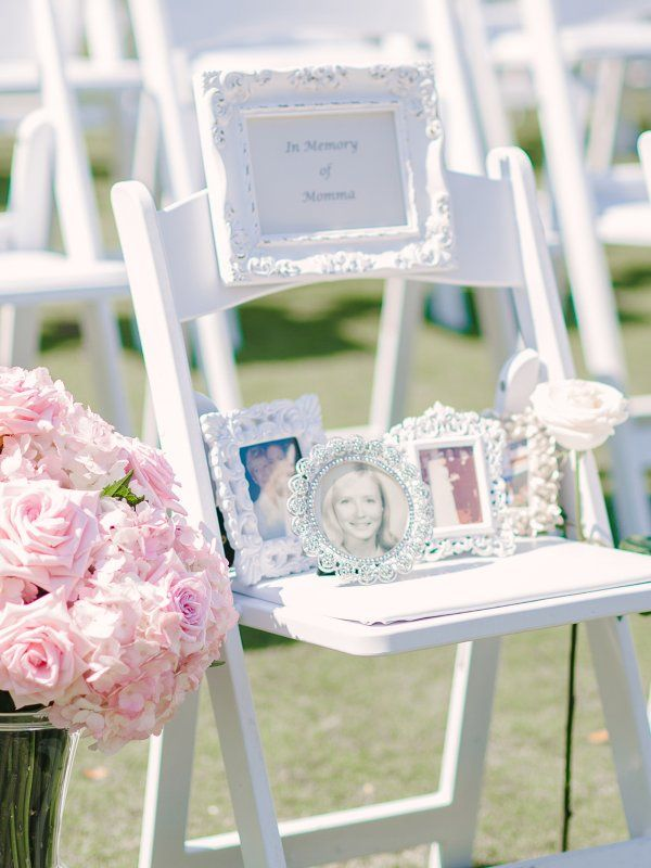 "An ""In Memoriam"" chair was placed in the front row of the ceremony with photos of the bride and her late mother so that she could be there in spirit with the couple on their big day.:"