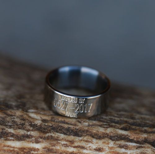 Solid metal wedding band with custom engraving. Handcrafted by Staghead Designs.