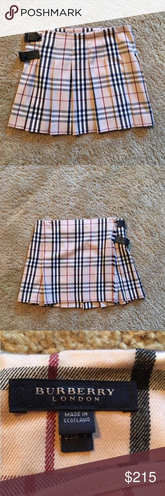 Burberry skirt (authentic) Cute pleated Burberry skirt. Size 6. Excellent condition. Burberry Skirts Mini